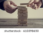 close up of hands putting... | Shutterstock . vector #610398650