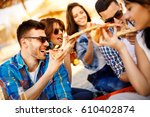happy people eating pizza and... | Shutterstock . vector #610402874