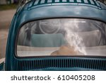 hat in the back of a car | Shutterstock . vector #610405208