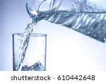 pouring water from pitcher into ... | Shutterstock . vector #610442648