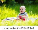 Adorable Baby Boy Eating Apple...