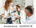 dentist and her female... | Shutterstock . vector #610453178