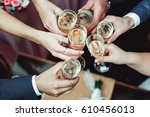 people hold in hands glasses... | Shutterstock . vector #610456013