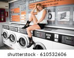 Pretty Blonde Woman In A Laundry