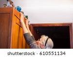 woman reaching for antique... | Shutterstock . vector #610551134
