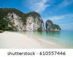 white sand cliff beach at... | Shutterstock . vector #610557446