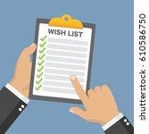 wish list clipboard in hands... | Shutterstock .eps vector #610586750