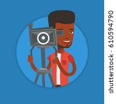 african cameraman looking... | Shutterstock .eps vector #610594790