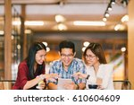 young asian college students or ... | Shutterstock . vector #610604609