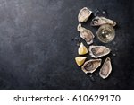 opened oysters  ice and lemon... | Shutterstock . vector #610629170