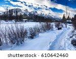 spring creek snowy path near... | Shutterstock . vector #610642460