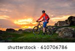 cyclist with his mountain bike... | Shutterstock . vector #610706786
