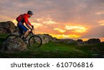 cyclist riding the mountain... | Shutterstock . vector #610706816