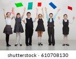 a group of children in uniforms ...   Shutterstock . vector #610708130