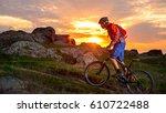 cyclist riding the mountain... | Shutterstock . vector #610722488