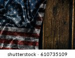 usa flag on a wood surface | Shutterstock . vector #610735109