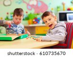 cute kids with special needs... | Shutterstock . vector #610735670