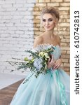 bride in a beautiful turquoise... | Shutterstock . vector #610742813