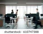 blurry businesspeople in dark... | Shutterstock . vector #610747388