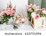 bouquet of flowers and florist... | Shutterstock . vector #610751096