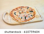 pizza margherita made with... | Shutterstock . vector #610759604