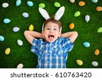 funny little boy with bunny... | Shutterstock . vector #610763420