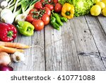 vegetables on wooden table | Shutterstock . vector #610771088