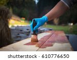hand applying copper based... | Shutterstock . vector #610776650