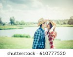 Small photo of A beautiful, loving couple in cowboy style is having a good time.Couple kissing