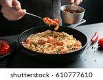 woman adding sauce to chicken... | Shutterstock . vector #610777610