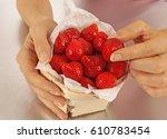 girl selecting strawberries | Shutterstock . vector #610783454