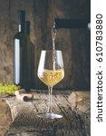 wine. glass of white wine in...   Shutterstock . vector #610783880