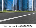 clean asphalt road with city...   Shutterstock . vector #610785074