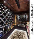Small photo of luxury cellar of prestigious house, shelves full of bottles