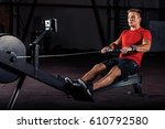 fitness young man using rowing... | Shutterstock . vector #610792580