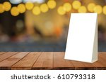 empty brown wooden table and... | Shutterstock . vector #610793318
