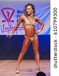 Small photo of MAASTRICHT, THE NETHERLANDS - OCTOBER 25, 2015: Female physique model Esther Blom shows her best front pose at championship on stage at the World Grandprix Bodybuilding and Fitness of the WBBF-WFF