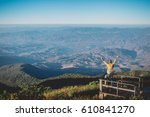 feeling freedom man on the top... | Shutterstock . vector #610841270