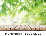 empty wooden table with blurred ... | Shutterstock . vector #610842923