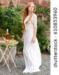 beautiful woman drinking wine...   Shutterstock . vector #610853960