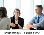 three business colleagues... | Shutterstock . vector #610855490