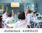 student hands up asking a... | Shutterstock . vector #610856123