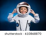 little girl in space suit... | Shutterstock . vector #610868870