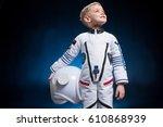cute little boy in space suit... | Shutterstock . vector #610868939