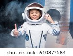 cute little girl in astronaut... | Shutterstock . vector #610872584