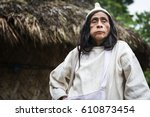Small photo of Sierra Nevada de Santa Marta, Colombia - March 8, 2014: Kogi Mamas (shaman) chewing coca leaves in front of a hut in the forest in the Sierra Nevada de Santa Marta, Colombia