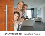 family of four opening house... | Shutterstock . vector #610887113