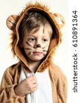Small photo of Dreamy portrait of the boy dressed for lion with whiskers and mane