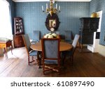 "Small photo of FRANKFURT-AM-MAINE, GERMANY - MAY 9, 2014. Blue Room at Goethe-Haus in Frankfurt, with furniture. The story goes that Goethe completed final draft of ""Goetz of Berlichinger"" done at round dining table"