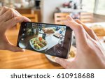 taking photo at breakfast on... | Shutterstock . vector #610918688